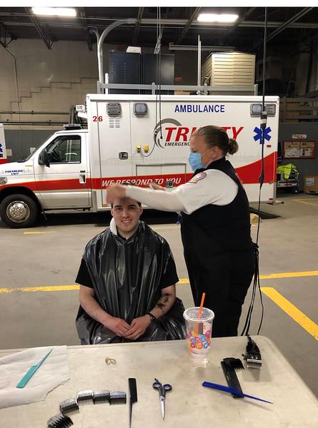 Erin Gardner gives Ryan Donofrio Ralls a hair cut
