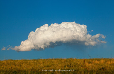 A storm cloud forms on a summer afternoon, Aurora Colorado