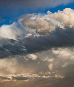 A storm forms on a summer afternoon, Aurora Colorado Mammatus clouds look like giant cotton-balls