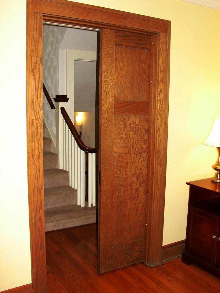 Pocket door from living room to stairwell