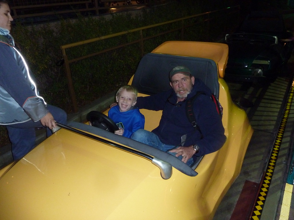 Grandpa and Elliott drive a go-cart