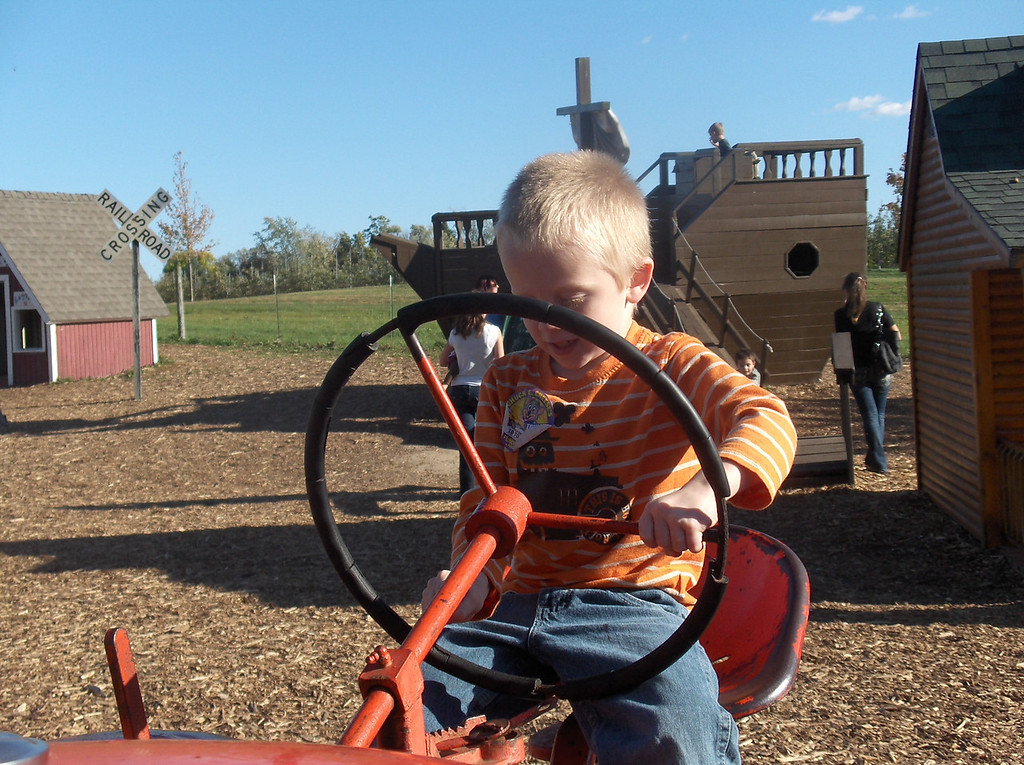 Elliott driving the tractors