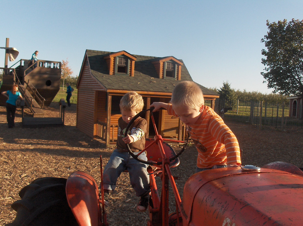 Elliott and Soren on the tractor