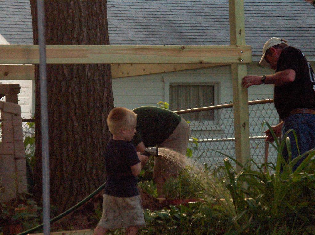 Elliott helps Daddy and Grandpa build the sandbox