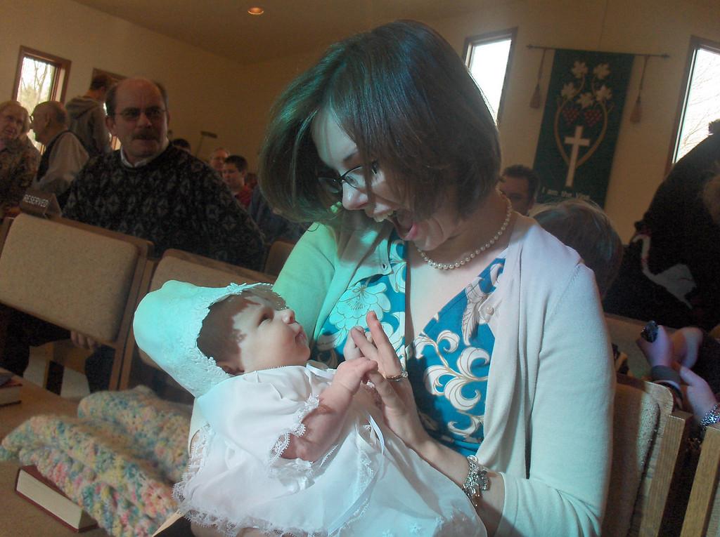 Jennifer Swenson holding Olive Oldenburg at her baptism. November 2008