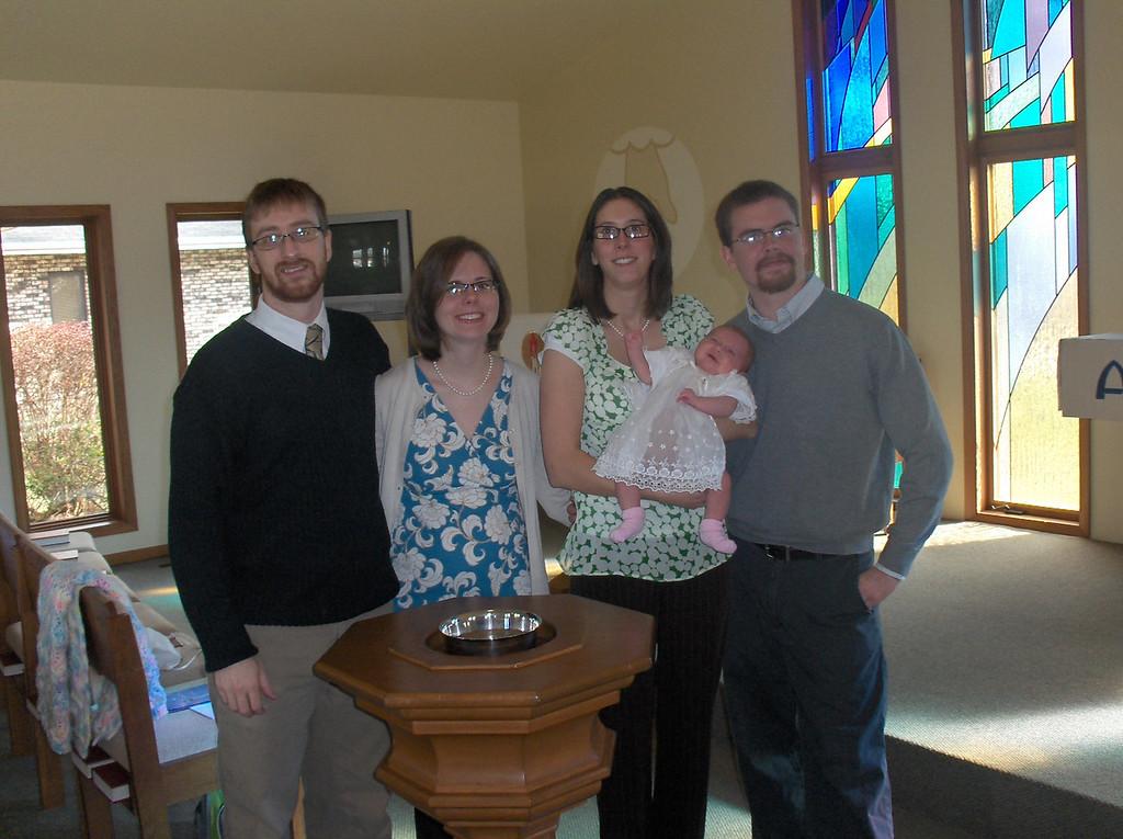 Olive Oldenburg's baptism. Olive with her parents Michael and Sarah and Godparents Joshua and Jennifer Swenson.  November 2008