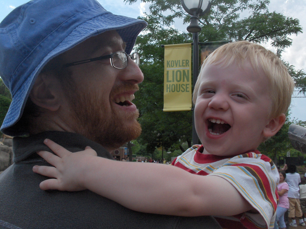 Elliott and Joshua Swenson looking at the lions at the Lincoln Park zoo in Chicago.  June 2008