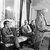 Photograph of Paul E. Tsongas with three males listening to Tip O'Neill speak