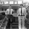 Black and white photograph of Paul Tsongas and unidentified man descending steps