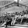 Photograph of Paul E. Tsongas with group of students on Capitol steps