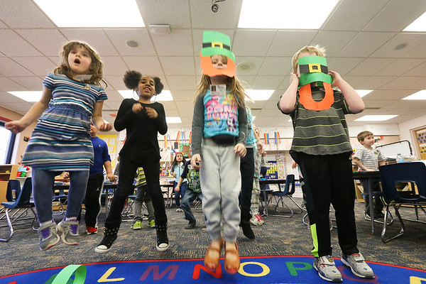 "LEANDRA BEABOUT | THE GOSHEN NEWS<br /> Kindergarten students in Carrie Garber's class jump and sing along to ""Dance Dance Leprechaun Dance"" by the Kiboomers."