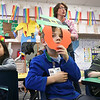LEANDRA BEABOUT | THE GOSHEN NEWS<br /> Kindergartener Henry Jeeves, center, watches traditional Irish dancing while his teacher, Carrie Garber, explains a few Irish traditions to the class.