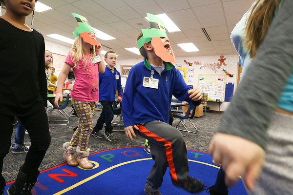 LEANDRA BEABOUT | THE GOSHEN NEWS<br /> Kindergartener Henry Jeeves, center,  and his classmates tries some Irish dance steps in their classroom at West Goshen Elementary School.
