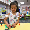 LEANDRA BEABOUT | THE GOSHEN NEWS<br /> Aubrey Barcena, a kindergartener at West Goshen Elementary School, works on her St. Patrick's Day craft.