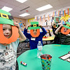 LEANDRA BEABOUT | THE GOSHEN NEWS<br /> Lillyonna Fouts, left, and her fellow kindergarten classmates hold up their leprechaun craft the day before St. Patrick's Day at West Goshen Elementary School.