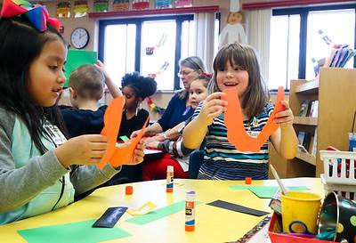 "LEANDRA BEABOUT   THE GOSHEN NEWS Allison Calderon, left, and Gemma Stickel hold up the ""leprechaun beard"" of their St. Patrick's Day hats in their kindergarten classroom at West Goshen Elementary School."