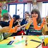 "LEANDRA BEABOUT | THE GOSHEN NEWS<br /> Allison Calderon, left, and Gemma Stickel hold up the ""leprechaun beard"" of their St. Patrick's Day hats in their kindergarten classroom at West Goshen Elementary School."
