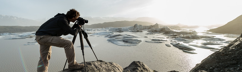 Photographer shooting the Hoffellsjökull glacier in Iceland during sunset with a magic sunlight