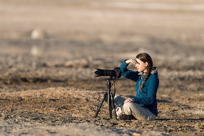 Photographer shooting wildlife at the Laguna Blanca in Bolivia