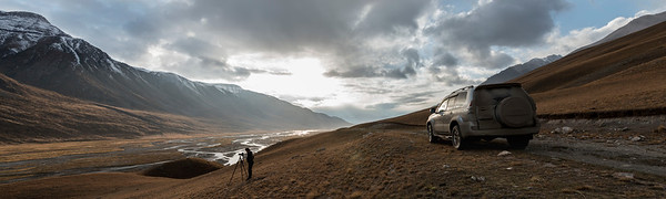 Photographer at sunset photographing the in a valley at the Eki Naryn Region in Kyrgyzstan