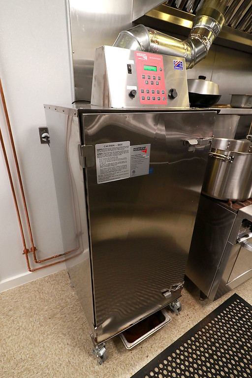 . The Local Spot in Fitchburg is expanding and with a new BBQ restaurant next to their spot on Main Street. They are calling  it TJ\'s BBQ. This is their smoker they will be using at their new place, TJ\'s. SENTINEL & ENTERPRISE/JOHN LOVE