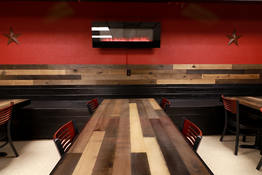 . The Local Spot in Fitchburg is expanding and with a new BBQ restaurant next to their spot on Main Street. They are calling  it TJ\'s BBQ. They have a digital fireplace on the wall in the TJ\'s. SENTINEL & ENTERPRISE/JOHN LOVE