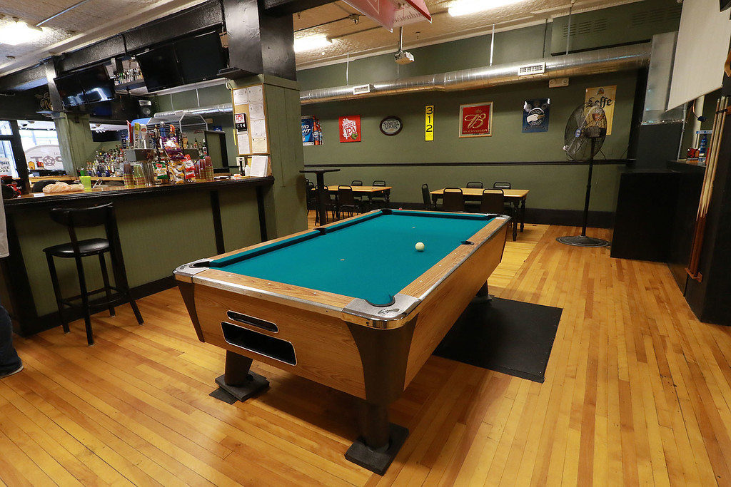 ". The Local Spot in Fitchburg is expanding and with a new BBQ restaurant next to their spot on Main Street. They are calling  it TJ\'s BBQ. This is a view one if one of the pool tables they have at the ""The Local Spot.\"" SENTINEL & ENTERPRISE/JOHN LOVE"