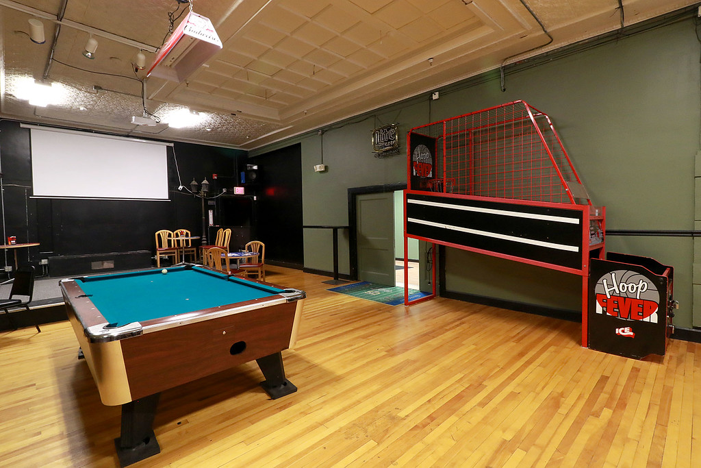 ". The Local Spot in Fitchburg is expanding and with a new BBQ restaurant next to their spot on Main Street. They are calling  it TJ\'s BBQ. This is a view one if one of the pool tables and one of the games they have at the ""The Local Spot.\"" SENTINEL & ENTERPRISE/JOHN LOVE"