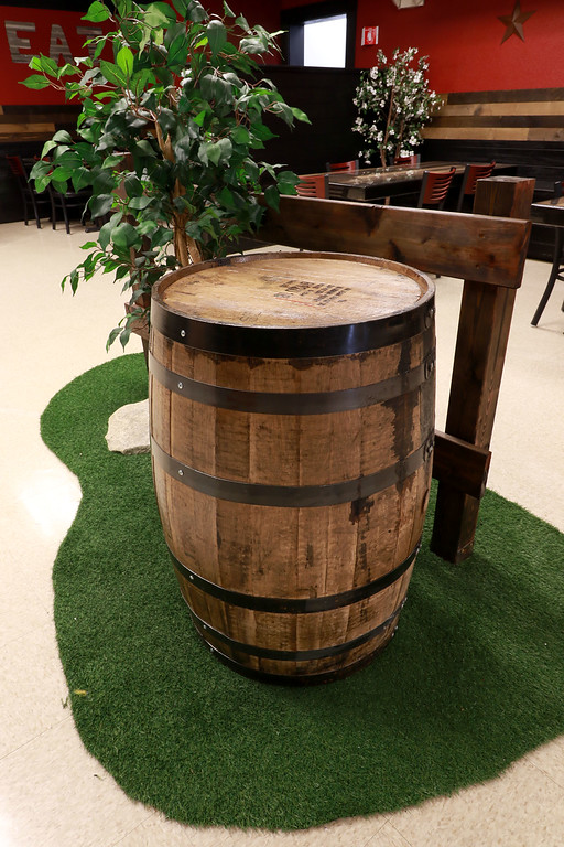 . The Local Spot in Fitchburg is expanding and with a new BBQ restaurant next to their spot on Main Street. They are calling  it TJ\'s BBQ. This barrel they have in the center of restaurant is a Jim Bean Whiskey barrel. SENTINEL & ENTERPRISE/JOHN LOVE