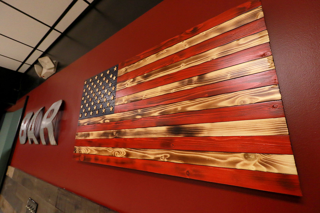 . The Local Spot in Fitchburg is expanding and with a new BBQ restaurant next to their spot on Main Street. They are calling  it TJ\'s BBQ. This American flag hangs in their new place, TJ\'s. SENTINEL & ENTERPRISE/JOHN LOVE