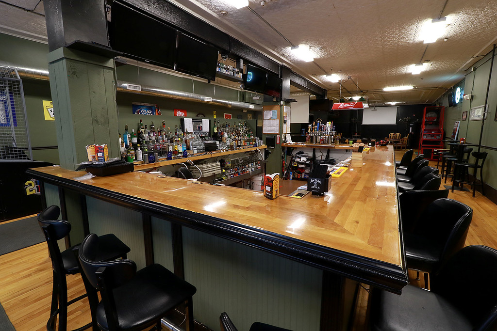 ". The Local Spot in Fitchburg is expanding and with a new BBQ restaurant next to their spot on Main Street. They are calling  it TJ\'s BBQ. This is a view of  the bar they already have at the ""The Local Spot.\"" SENTINEL & ENTERPRISE/JOHN LOVE"