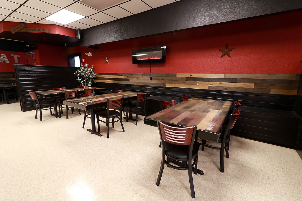 . The Local Spot in Fitchburg is expanding and with a new BBQ restaurant next to their spot on Main Street. They are calling  it TJ\'s BBQ. A view some of the seating in TJ\'s. SENTINEL & ENTERPRISE/JOHN LOVE