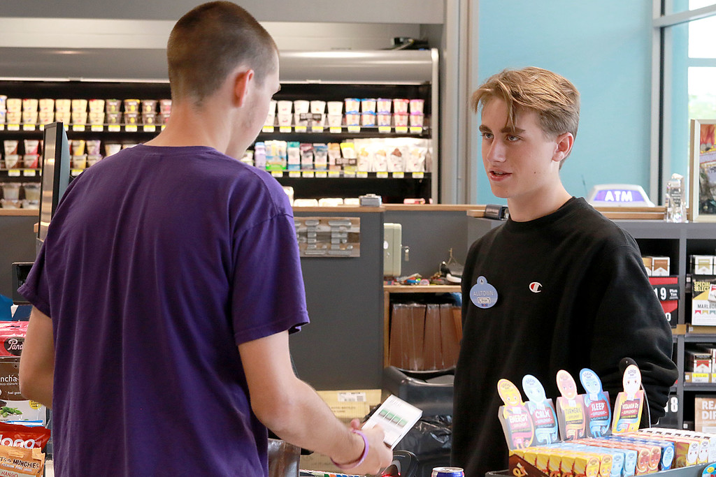 . Ashburnham\'s newly-built Alltown convenience store opened to the public on Thursday, August 23, 2018. Employee Brian Hickey, 18, of Ashburnham rings up a customer early on their opening day. SENTINEL & ENTERPRISE/JOHN LOVE