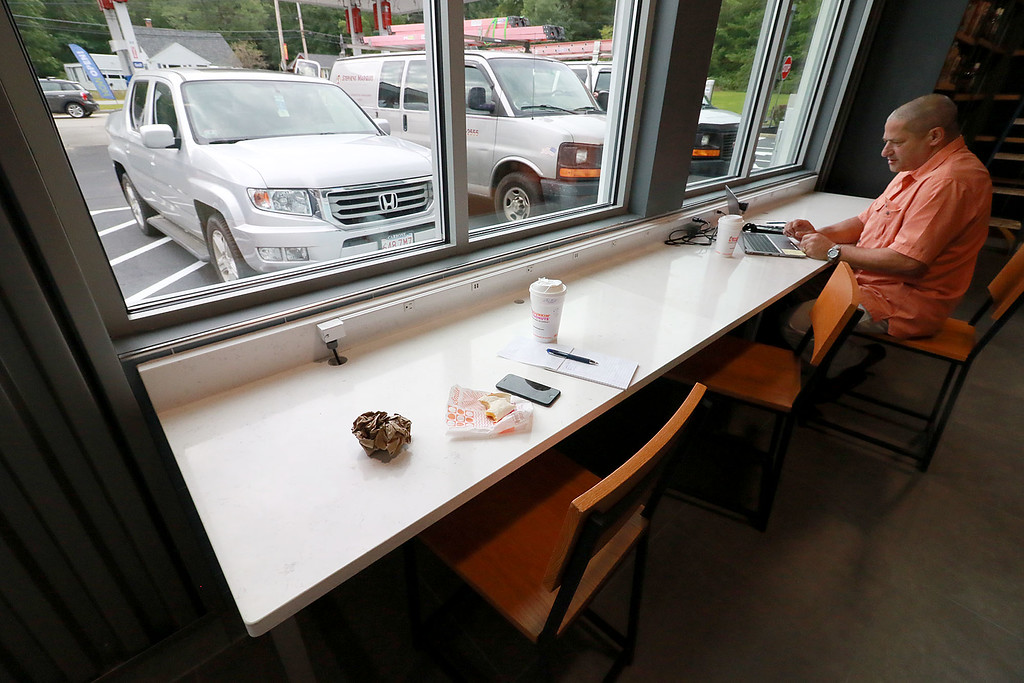 . Ashburnham\'s newly-built Alltown convenience store opened to the public on Thursday, August 23, 2018. Craig Parkin the store\'s retail automation coordinator works at the stores computer/charging station for customers on opening day. SENTINEL & ENTERPRISE/JOHN LOVE
