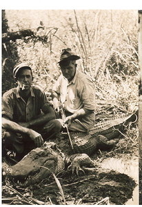 Hunters with gator
