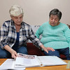 Mary Parke Plummer and her sister Myrle Phaneuf, better known as Jinxie, look through a scrape book made by their brother's wife Susan as they talk about being reunited with him after 68 years. SENTINEL & ENTERPRISE/JOHN LOVE
