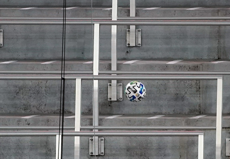 soccer ball bounces out of play during a game in a stadium closed to fans because of Covid 19.