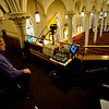 KRISTOPHER RADDER — BRATTLEBORO REFORMER<br /> Alfred New, a volunteer for Brattleboro Community TV, films an unannounced Mass during Lent on Saturday, March 21, 2020, that Father Justin Baker, of Saint Michael's Catholic Church, in Brattleboro, Vt., held. The Mass will air twice on Sunday and on Tuesday. The Mass, which is normally filmed, is a way people can still attend Lent Mass during the COVID-19 outbreak. This was the first time that normal Mass was canceled.