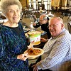 The SHSST kitchen made Marlene her favorite lunch for her last day: onion rings and frozen yogurt! She is pictured here with Dn. David.