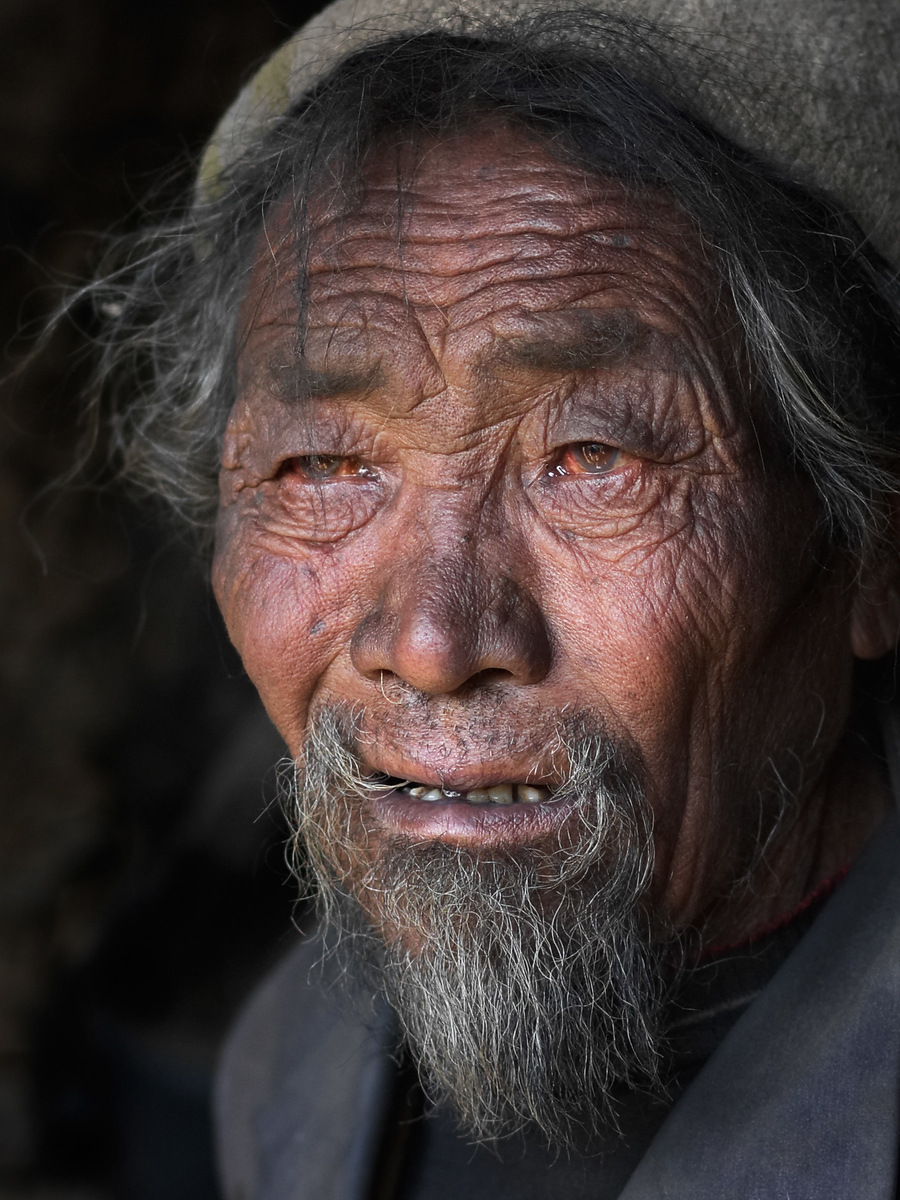 Fading away.  An old man in a Tibetan village