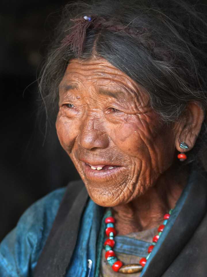 The yound girl shines through.  An old woman in a Tibetan village.
