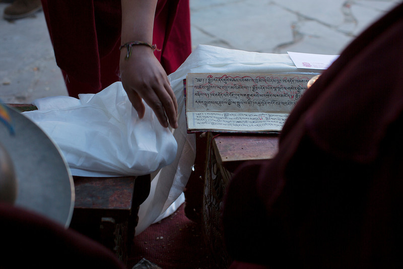 Placing a Khatak or Kata (Tibetan scarf symbolizing purity) with the symbol players