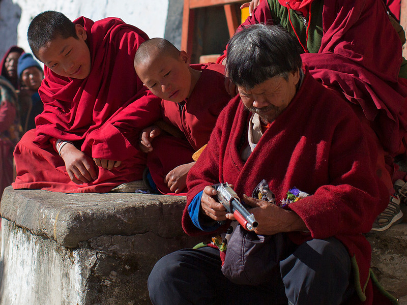 Young monks share their toy gun