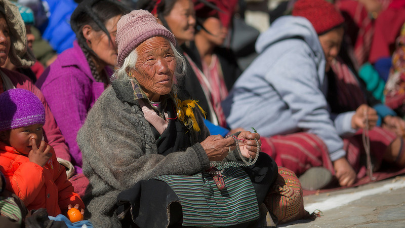 Old woman with prayer beads