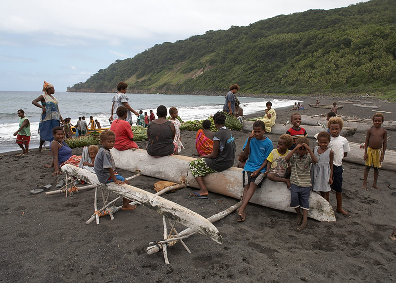 Receiving Cargo. Villagers get bananas of a boat in preparation for John Frum day