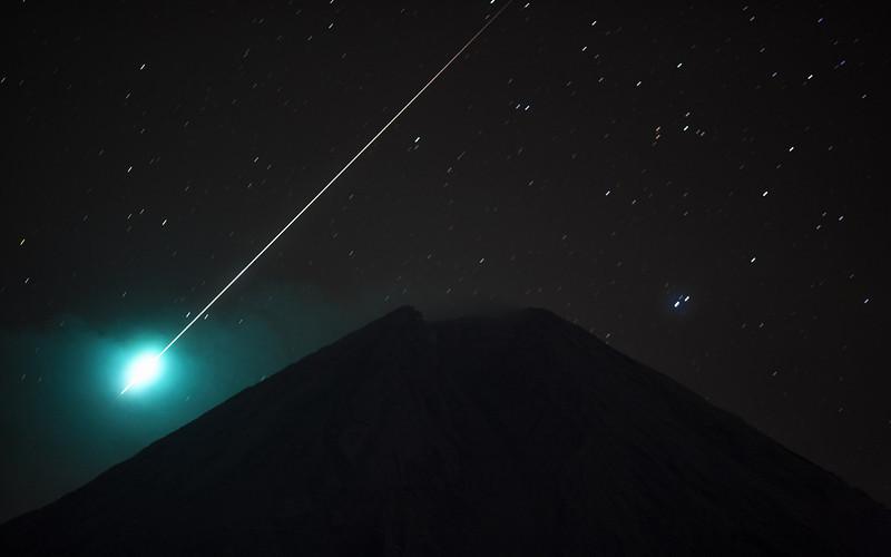 A meteor fireball over Mt Semeru volcano.  Java 2008