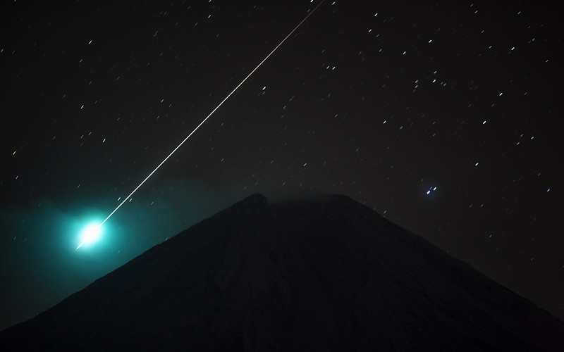 A meteor fireball over Mt Semeru volcano.  Java 2008