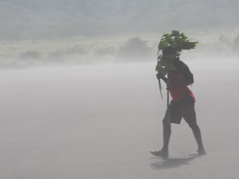 Walking the ash plain.  It can be very dusty so the locals have developed ways to protect themselves.