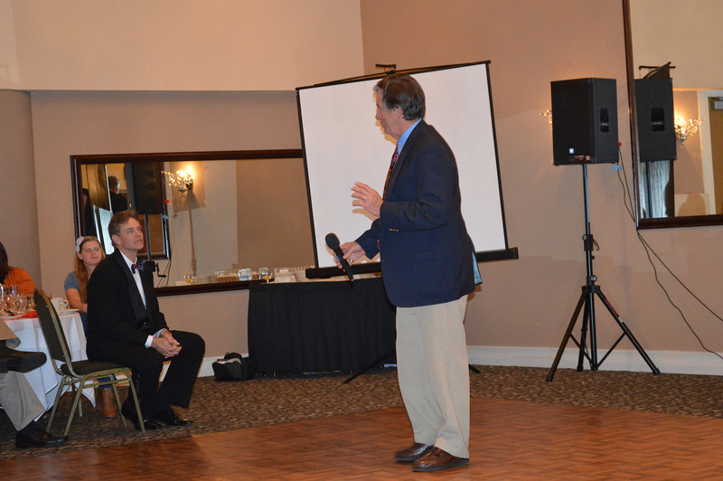 Coach Mike Self (1971) addressing the audience.