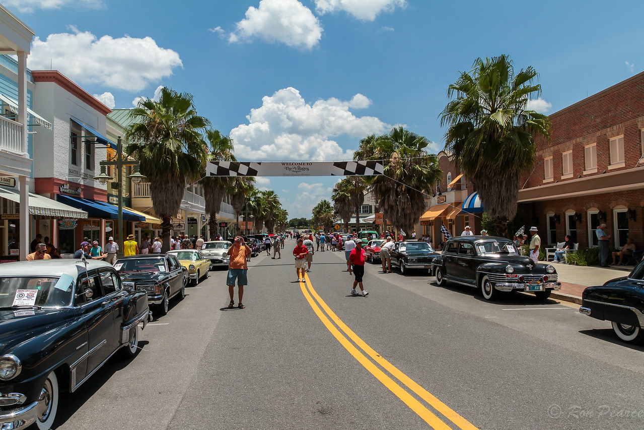 "Classic cars from The Villages Regional Antique Automobile Club of America line the road leading to the finish line of the ""Great Race""."